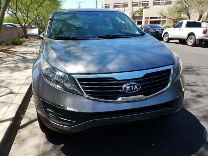 2012 GRAY Kia Sportage (KNDPB3A28C7) with an 2.4L V6 DOHC 24V engine, M transmission, located at 323 E Dunlap Ave., Phoenix, AZ, 85020, (602) 331-9000, 33.567677, -112.069000 - Photo #0