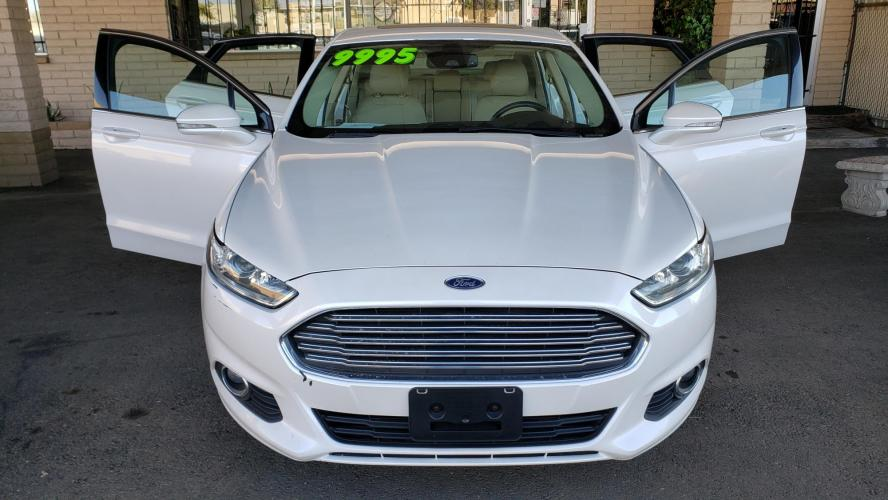 2013 WHITE Ford Fusion Hybrid SE (3FA6P0LU8DR) with an 2.0L L4 DOHC 16V HYBRID engine, CVT transmission, located at 323 E Dunlap Ave., Phoenix, AZ, 85020, (602) 331-9000, 33.567677, -112.069000 - Photo #0
